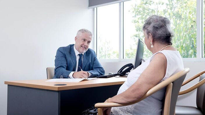 Doctor Consulting an Elderly patient